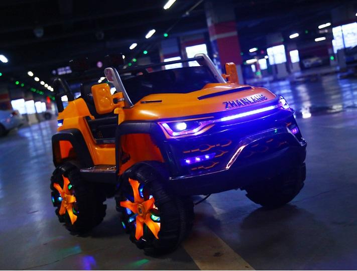 xe ô tô điện trẻ em KP- 6699 đèn bánh xe